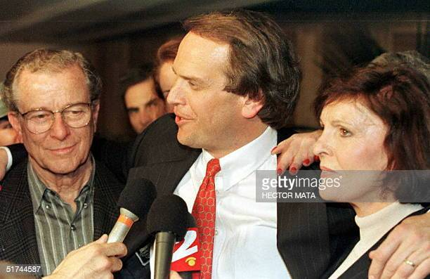 Lou Brown and Juditha Brown , the parents of murder victim Nicole Brown Simpson, stand 04 February with their attorney John Kelley in front of the...