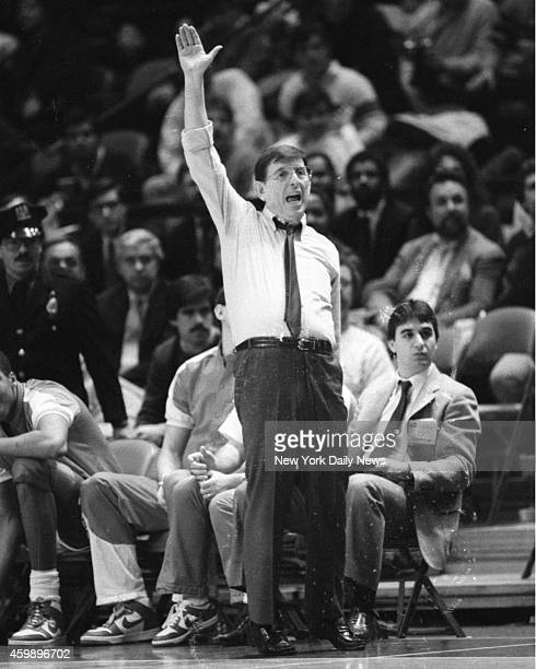 Lou Carnesecca, St. John's head basketball coach and head cheerleader, gives it the old college try on sidelines of Madison Square Garden as his...