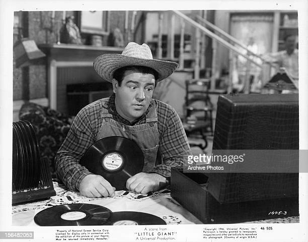 Lou Costello plays records in a scene from the film 'Little Giant' 1946