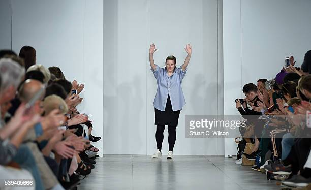 Lou Dalton gestures to guests following her show during The London Collections Men SS17 at BFC Show Space on June 11 2016 in London England