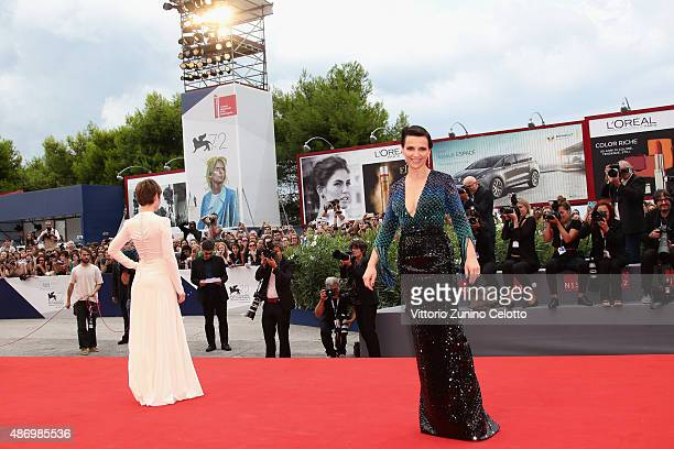 Lou de Laage and Juliette Binoche attend a premiere for 'The Wait' during the 72nd Venice Film Festival on September 5 2015 in Venice Italy