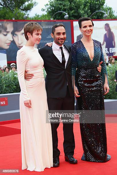 Lou de Laage Director Piero Messina and Juliette Binoche attend a premiere for 'The Wait' during the 72nd Venice Film Festival on September 5 2015 in...