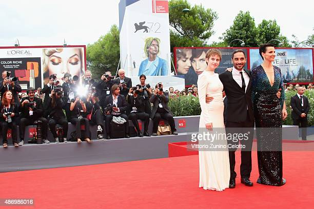 Lou de Laage Piero Messina and Juliette Binoche attend a premiere for 'The Wait' during the 72nd Venice Film Festival on September 5 2015 in Venice...