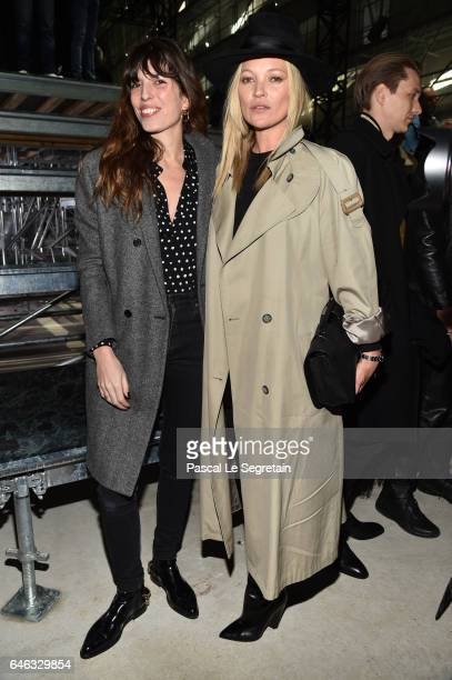 Lou Doillon and Kate Moss attend the Saint Laurent show as part of the Paris Fashion Week Womenswear Fall/Winter 2017/2018 on February 28 2017 in...
