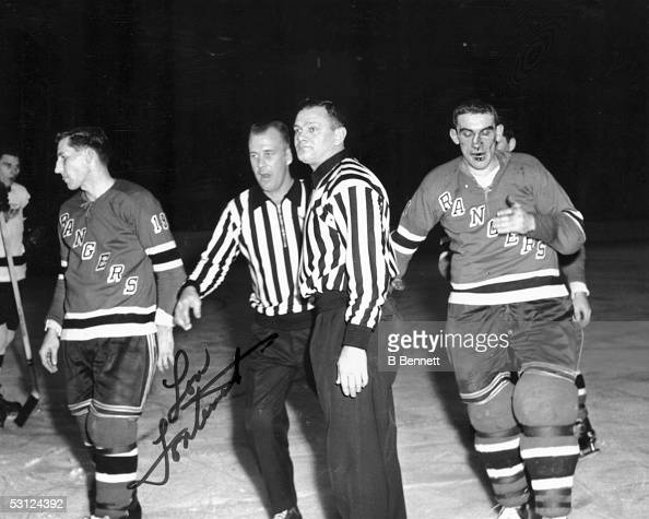 Lou Fontinato of the New York Rangers is bloodied after a ...