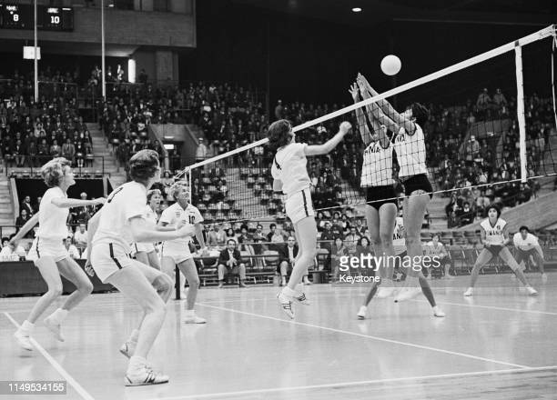 Lou Galloway of the United States attempts to spike the ball against the defence of Rumania during their Women's Olympic Volleyball Tournament match...