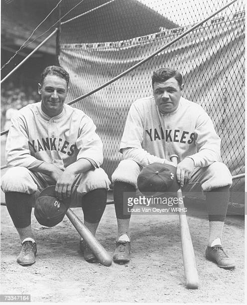 Lou Gehrig and Babe Ruth sit by the batting cage at League Park Indians vs. Yankees July 1927.