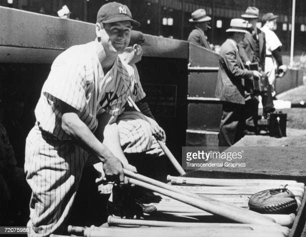 Lou Gehrig, first baseman for the New York Yankees, poses on the dugout steps of Yankee Stadium shortly before he plays in his 2000th consecutive...