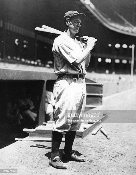 Lou Gehrig, first baseman for the New York Yankees, poses with bats before a game at Yankee Stadium in 1934.