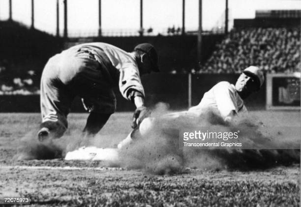 Lou Gehrig first baseman for the New York Yankees puts a tag on St Louis Browns first baseman George Sisler during a game at Sportsmans Park in St...