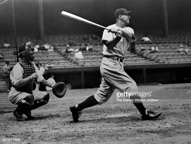 Lou Gehrig, first basemen for the New York Yankees, hitting the ball during warm p before a game, circa 1925.