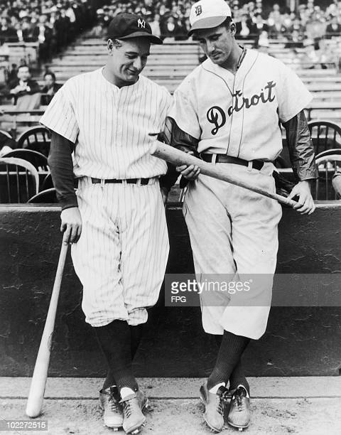 Lou Gehrig of the New York Yankees and Hank Greenberg of the Detroit Tigers chatting at the Yankee Stadium before the first game of the current...