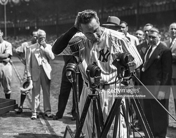 Lou Gehrig of the New York Yankees is shown before the mic delivering his farewell speech on Lou Gehrig Day on July 4, 1939 at Yankee Stadium in the...