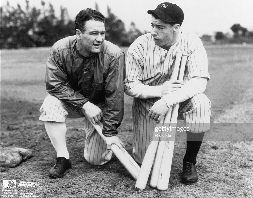 Lou Gehrig #4 of the New York Yankees kneels with teammate Joe DiMaggio #5 before a spring training game on March 7, 1936 in St. Petersburg, Florida.