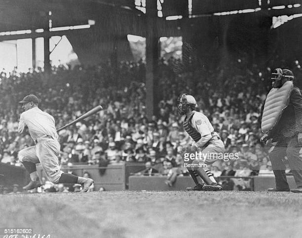 Lou Gehrig of the Yankees hitting a 3-bagger in Sunday's game with Washington at Yankee Stadium.