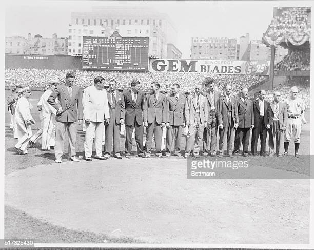 Lou Gehrig the 'Iron Man' for the New York Yankees stands with head bowed at Yankee Stadium 7/4 on the occasion of 'Lou Gehrig Day' his teammates are...