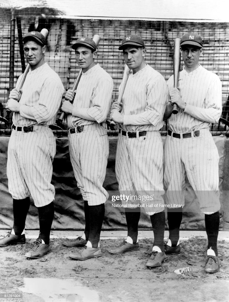 Lou Gehrig #4, Tony Lazerri, Mark Koenig #2, Joe Dugan of the New York Yankees pose with their bat before a season game. Lou Gehrig played for the New York Yankees from 1923-1939, Tony Lazerri from 1926-1937, Mark Koenig from 1925-1930, Joe Dugan from 1922-1928.