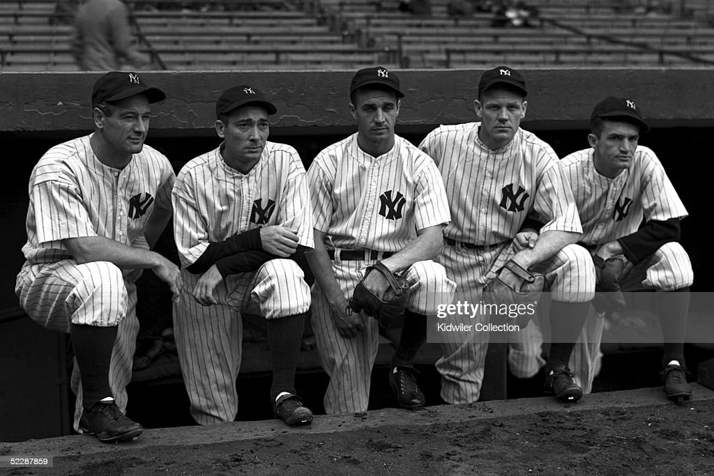 Lou Gehrig #4, Tony Lazzeri #6, Frankie Crosetti #1, Red Rolfe #2 and Don Heffner #10 pose on top of the dugout steps as members of the New York Yankees infield on September 27, 1937 prior to the start of the World Series game against the New York Giants at Yankee Stadium in the Bronx, New York.