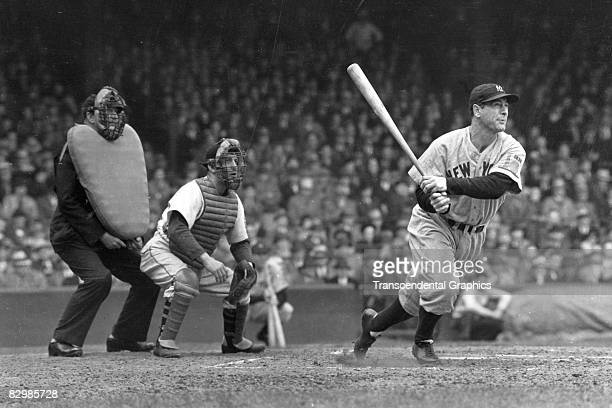 Lou Gehrig whacks a double into left center in a game at Yankee Stadium in 1938. Luke Sewell is the catcher for the opponent White Sox.