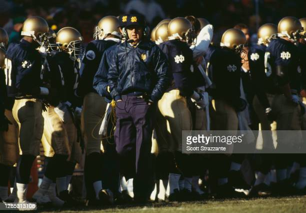 Lou Holtz, Head Coach for the University of Notre Dame Fighting Irish walks down the sideline during the NCAA Southeastern Conference college...