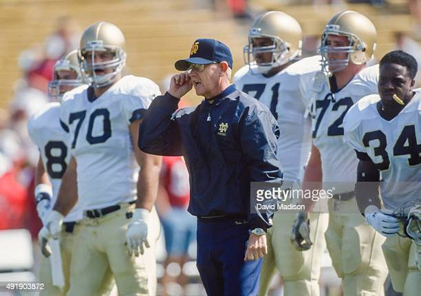 Lou Holtz, head coach of the Notre Dame Fighting Irish, coaches his team during an NCAA football game against the Stanford Cardinal played on October...