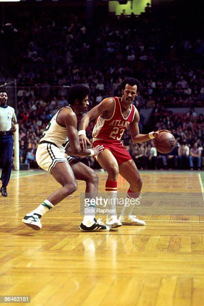 Lou Hudson of the Atlanta Hawks moves the ball up court against Don Chaney of the Boston Celtics during a game played in 1974 at the Boston Garden in...