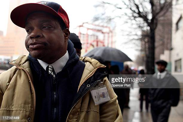 Lou Ingram joins thousands of job seekers wating in line to speak with potential employers at the Brooklyn Job Fair on April 13 2011 in the Brooklyn...