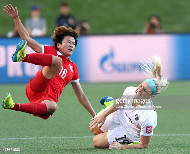 Lou Jiahui of China and Julie Johnston of the United States collide in the first half in the FIFA Women's World Cup 2015 Quarter Final match at...
