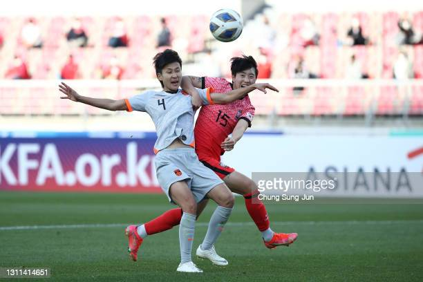 Lou Jiahui of China competes for the ball with Son Hwa-Yeon of South Korea during the Tokyo Olympics Women's Football Asian Final Qualifier 1st leg...