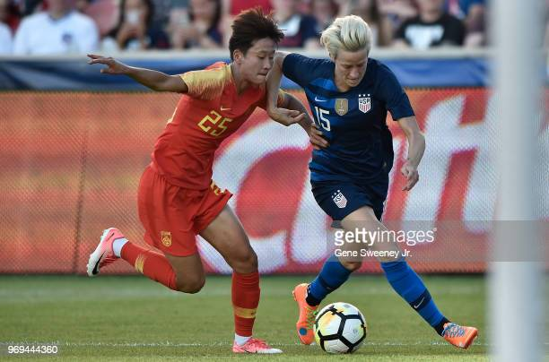 Lou Jiahui of China defends against Megan Rapinoe of the United States in the first half of an international friendly soccer match at Rio Tinto...