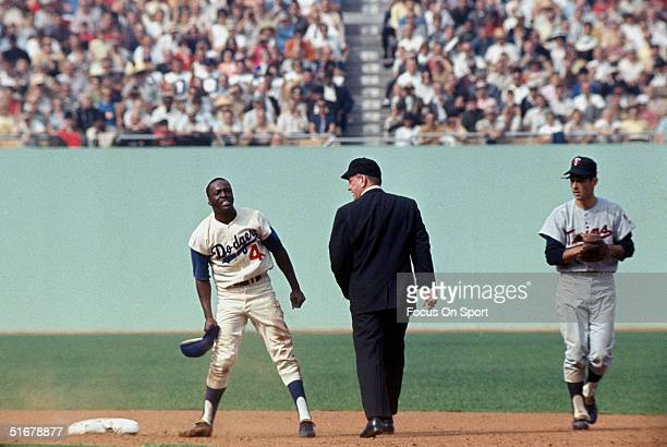 Lou Johnson of the Los Angeles Dodgers is called out at second base in the 1965 World Series against the Minnesota Twins at Dodger Stadium in Los...