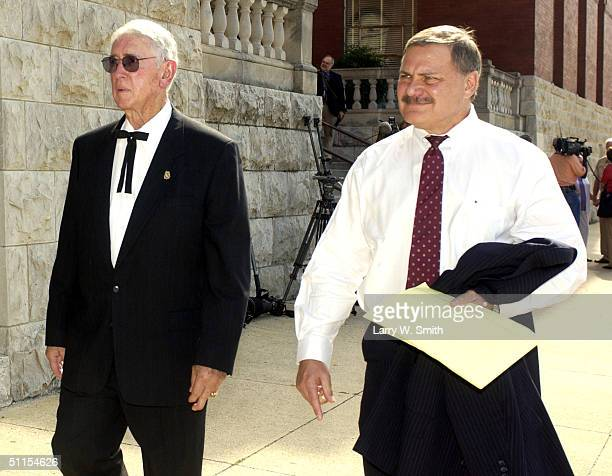 Lou Keel a member of the prosecution team leaves the Pittsburg County courthouse along with former District Attorney Bob Macy August 9 2004 in...