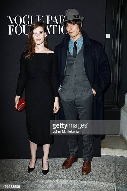 Lou Lesage and guest attend the Vogue Foundation Gala as part of Paris Fashion Week at Palais Galliera on July 9, 2014 in Paris, France.