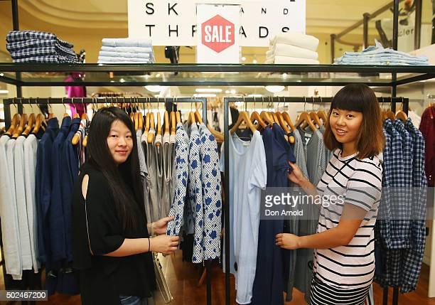 Lou Lu from China and Karen Zhang from Sydney check out merchandise inside the Myer city store during the Boxing Day sales on December 26 2015 in...
