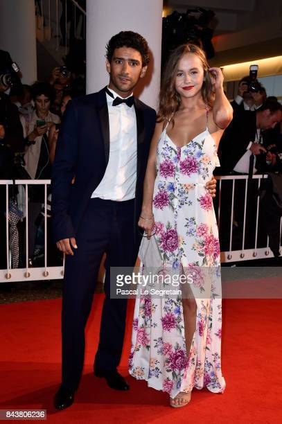 Lou Luttiau and Salim Kechiouche walk the red carpet ahead of the 'Mektoub My Love Canto Uno' screening during the 74th Venice Film Festival at Sala...