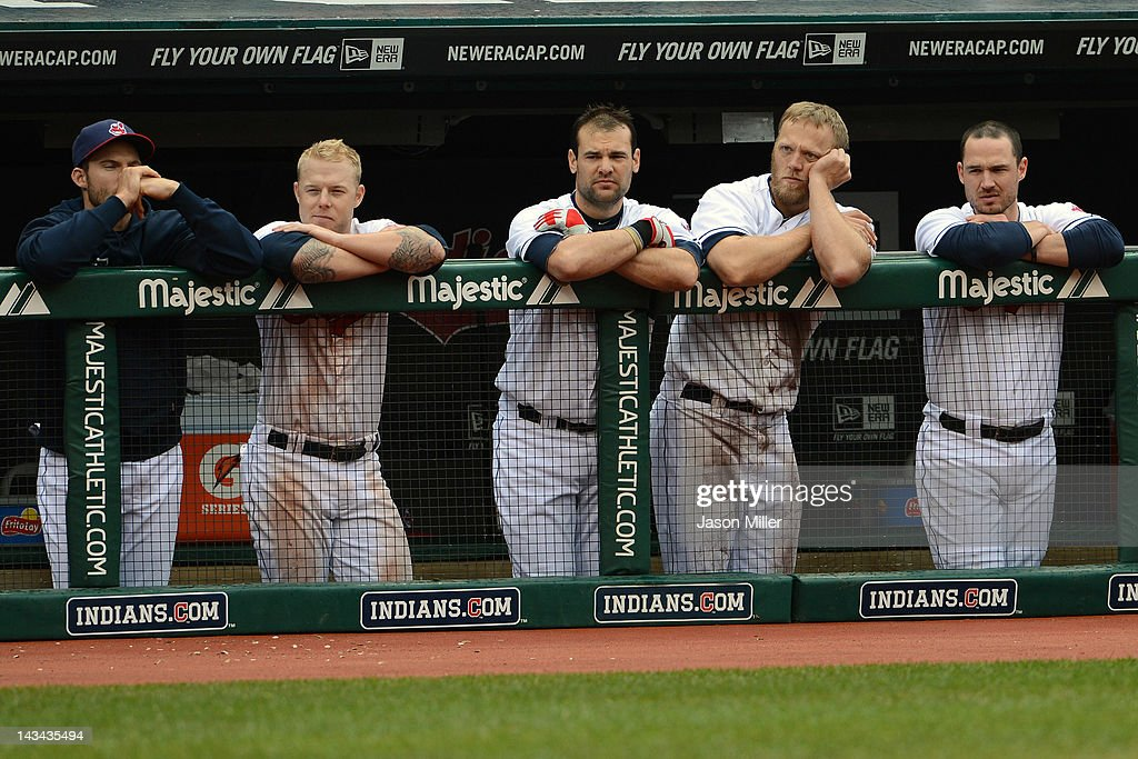Lou Marson #6 Aaron Cunningham #2 Casey Kotchman #35 Shelley Duncan #47 and Jack Hannahan #9 of the Cleveland Indians from the dugout during the ninth inning against the Kansas City Royals at Progressive Field on April 26, 2012 in Cleveland, Ohio. The Royals defeated the Indians 4-2.