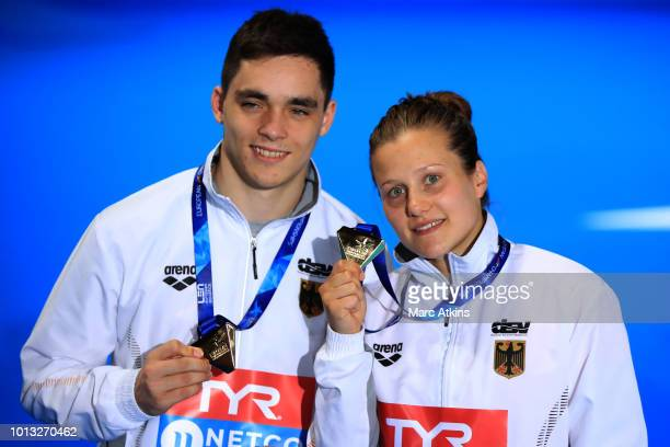 Lou Massenger and Tina Punzel of Germany pose with their Gold Medals after winning the Mixed Synchronised 3m Springboard final during the diving on...