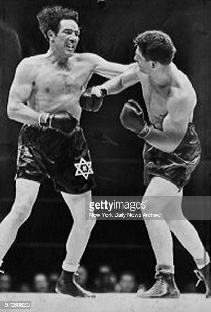 Lou Nova lands a right punch to the stomach of Max Baer during their fight on June 1 1939 at Yankee Stadium in the Bronx New York