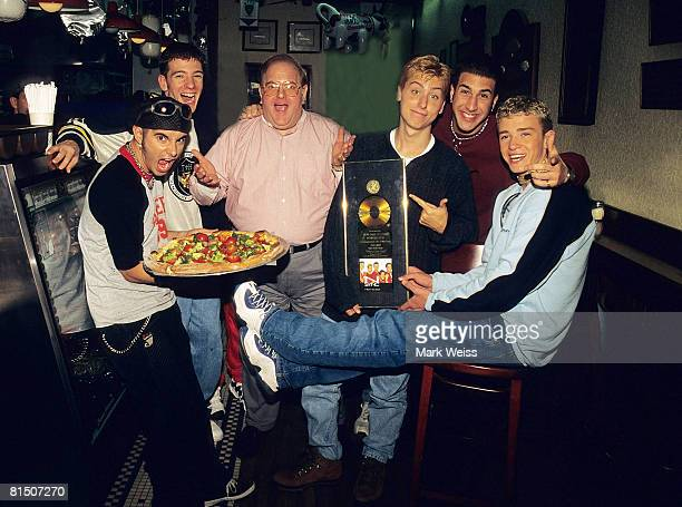 Lou Pearlman poses with N'Sync Chris Kirkpatrick JC Chasez Lance Bass Joey Fatone and Justin Timberlake seen at NYPD pizza in Miami circa 1996