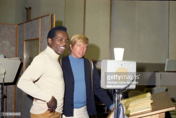 Lou Rawls and Don Randi pose for a portrait recording in the studio on July 18, 1967 in Los Angeles.