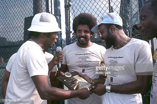 """Lou Rawls, Dexter Wensel and Billy Paul during WWRL Radio Station vs CBS Philadelphia International's """"Let's Clean Up The Ghetto"""" Team - May 17, 1977..."""