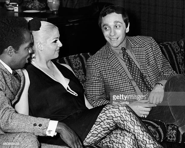 "Lou Rawls, Lana Jean Taylor and Sandy Baron attend the premiere party for ""If It's Tuesday, This Must Be Belgium"" on April 8, 1989 at Jack Haley Jr's..."