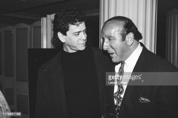 Lou Reed and Clive Davis attend a party circa 1988