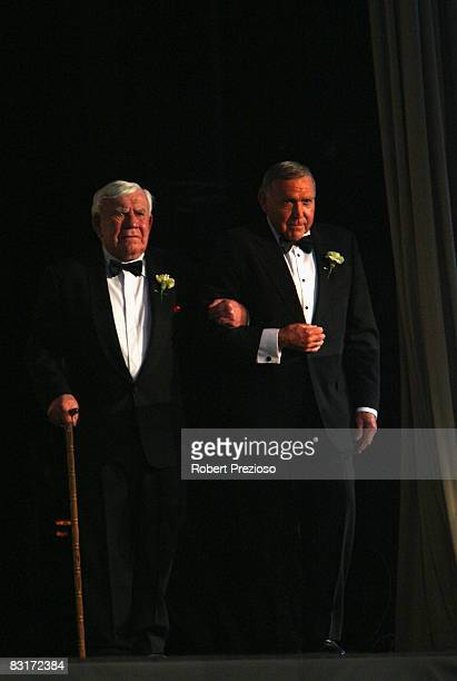 Lou Richards is escorted onto stage by Bob Skilton and is inducted during the 24th Sport Australia Hall Of Fame Dinner and Induction at Crown Casino...
