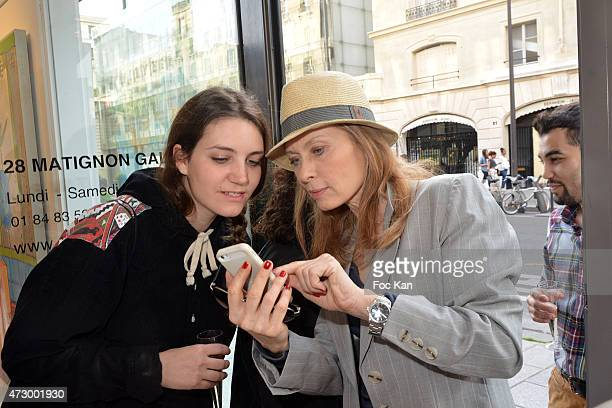 Lou Salasca and Valerie Steffen attend the Jacques Bral Exhibition Preview at 28 Matignon Gallery on May 11 2015 in Paris France