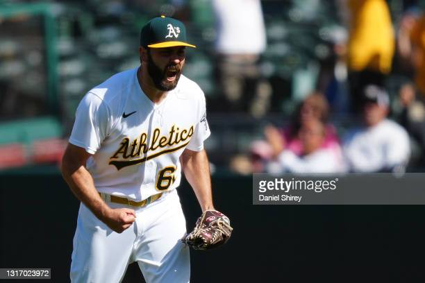 Lou Trivino of the Oakland Athletics celebrates beating the Tampa Bay Rays 6-3 at RingCentral Coliseum on May 08, 2021 in Oakland, California.