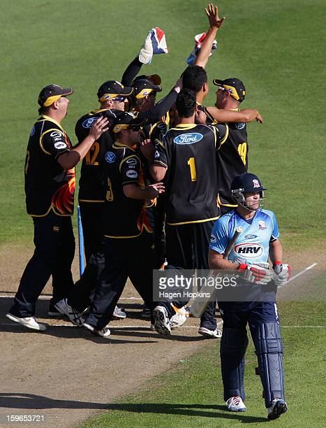 Lou Vincent of Auckland leaves the field after being dismissed by Malaesaili Tugaga of Wellington during the HRV Cup Twenty20 Preliminary Final...