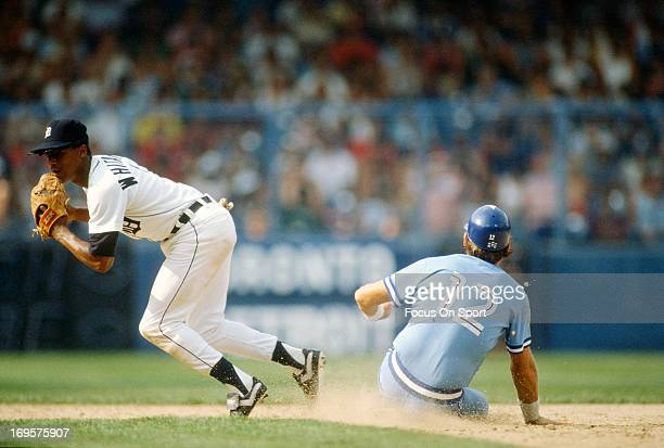 Lou Whitaker of the Detroit Tigers gets the putout at second base on Ernie Whitt of the Toronto Blue Jays during an Major League Baseball game circa...