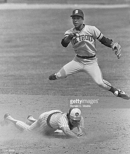 Lou Whitaker of the Detroit Tigers tries for a double play as Paul Molitor slides into second base during a game at County Stadium in the 1970s in...