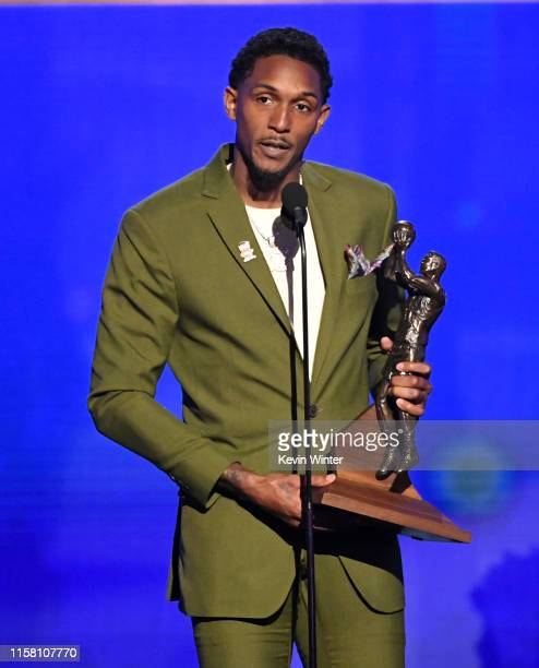 Lou Williams accepts the Kia NBA Sixth Man of the Year Award onstage during the 2019 NBA Awards presented by Kia on TNT at Barker Hangar on June 24...